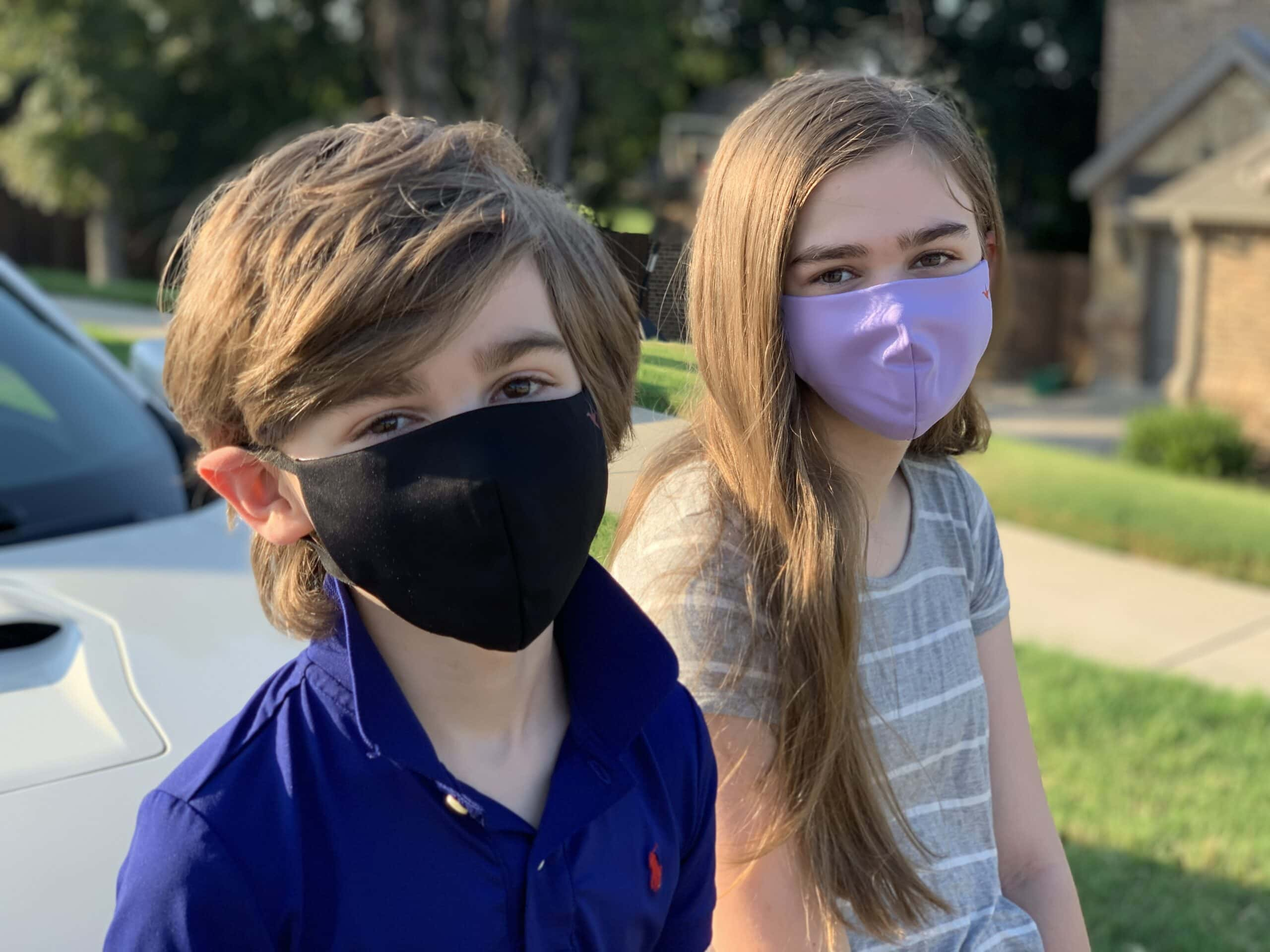 Boy and girl wearing Oura Air Mask Jr.