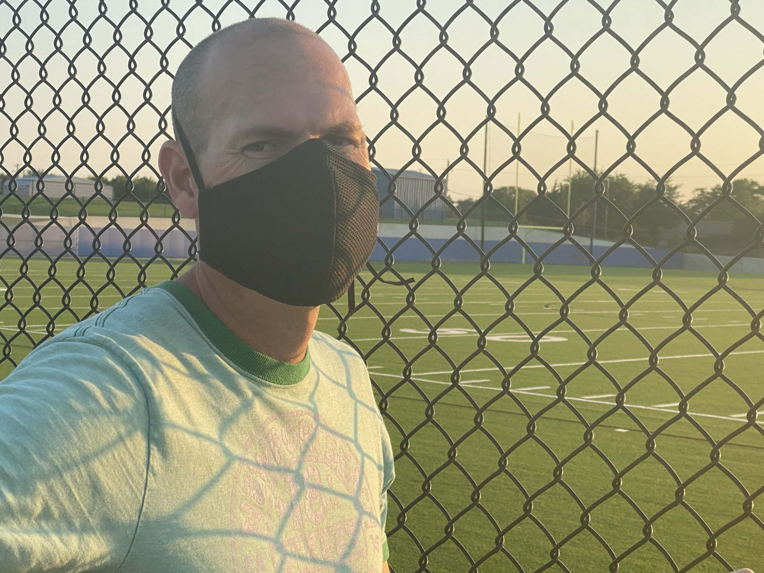 male wearing Sprye face mask from Arsenal wares