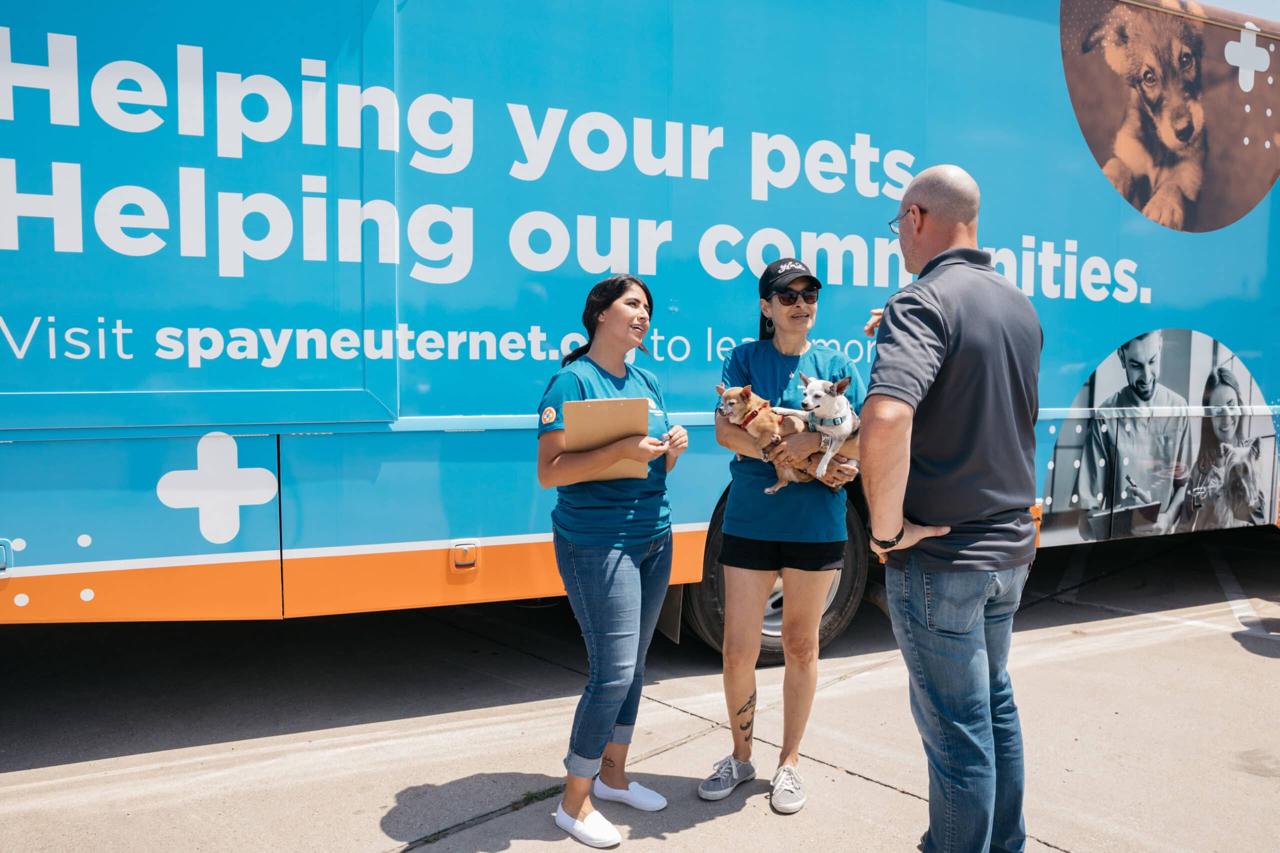 Spay neuter volunteers with mobile truck