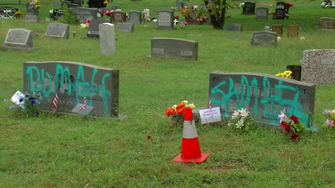 Somebody spray-painted graffiti on headstones in a historically Black cemetery in Austin 6