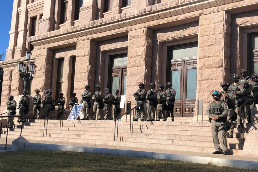 Armed pro-Trump protesters gather outside Texas state Capitol 6