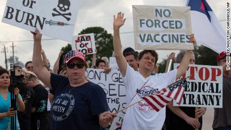 Employees protest against Houston hospital's policy that all staff must be vaccinated against Covid-19 6