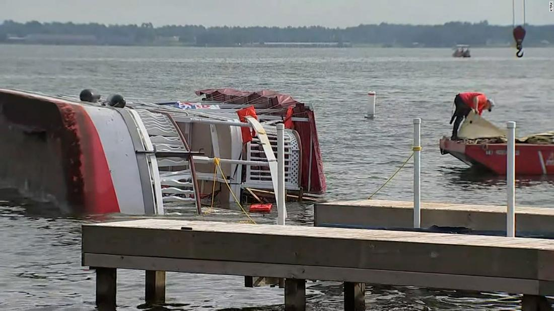 A man died after a party boat capsized on a Texas lake during bad weather 6