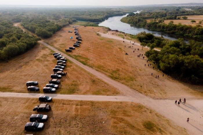 Texas governor approves miles-long steel barrier of police vehicles to deter the more than 8,000 migrants in Del Rio 6